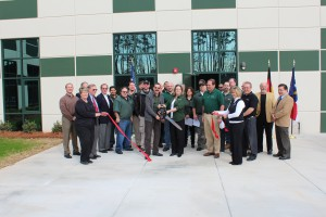 """Constantino Lannes, President of SENNEBOGEN LLC and the team cut the ribbon to open the newly expanded facility in Charlotte, North Carolina. """"This facility represents a commitment to our marketplace."""""""
