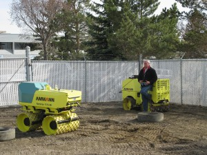 Peter Price, Area Sales Manager for Canada uses a remote control to demo a trench compactor.