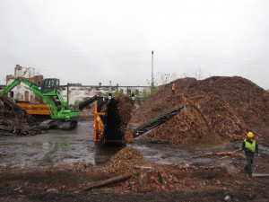 The 821 feeds a pair of grinders as part of maximizing the revenues from every demolition project.