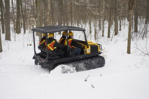 "2014 ARGO 8x8 XTD with ROPS, Roof and 18"" HD Rubber Tracks for 4 passengers operating in deep snow."