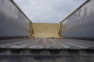 Titan's clean-out plow for the moving floor system was developed specifically for use with the horizontal panel design of THINWALL® trailers.