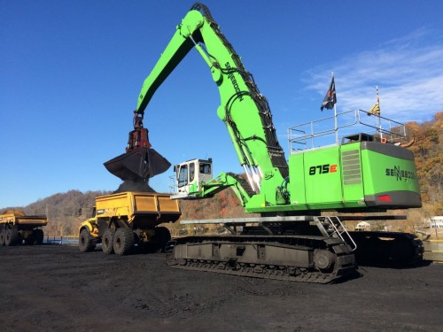 The 875 is fitted with a 14 yd. bucket to transfer coal to trucks from as many as 6 jumbo barges in a day.