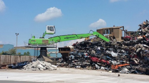 The combination of the boom and stick gives the operator the ability to reach and feed the shredder constantly.