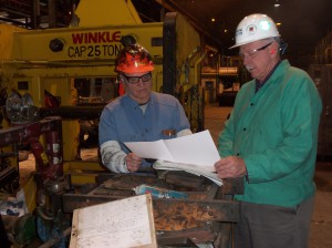 Kevin Lhota, (right), Production & Maintenance Senior Leader at the ATI Allegheny Ludlum steel plant and Tom Polczynski (left) of Winkle Industries review drawings for the next project.