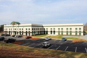 The view of the SENNEBOGEN facility with the 45,000 sq. ft. expansion. Today, SENNEBOGEN maintains a complete inventory of service parts and replacement components and serves the US, Canada and Central and South America.