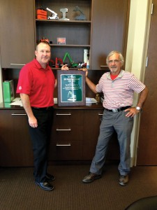 Presented at the annual dealer meeting, David Shea (L) and Emidio Greco proudly display their 10 year partnership award from SENNEBOGEN.
