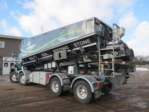 The custom-built 40 yard Stone Slinger truck was developed as a delivery system to support Landsource Organix' fleet of blower trucks.