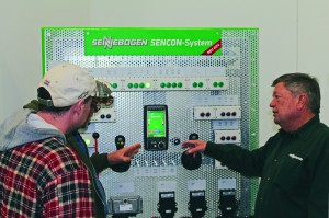 Chief Trainer, Roger Hardin reviews the SENNEBOGEN SENNCON-System with a couple of technicians.