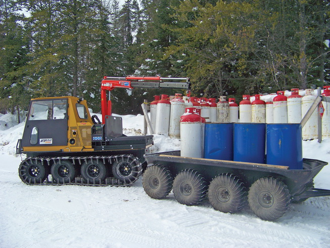 ARGO 8x8 Centaur equipped with Maxilift crane and flat bed, loading an ARGO 8 wheel trailer.