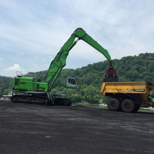 """The SENNEBOGEN 875 R-HD at the Donora Dock barge facility features a """"Green Hybrid"""" energy recovery system that reduces diesel costs by as much as 30%."""