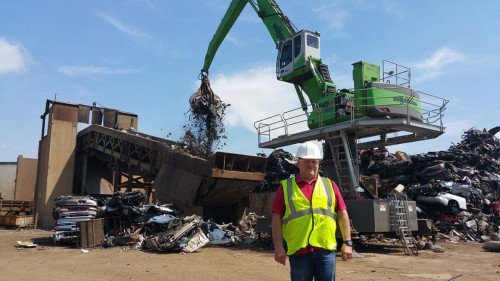Jeff Beebe in front of Ferrous Processing & Trading's new 840 E-Series Electric Machine.