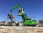 This GREEN EFFICIENCY 818 M E-Series is matched to a SENNEBOGEN grapple to maximize its productivity.